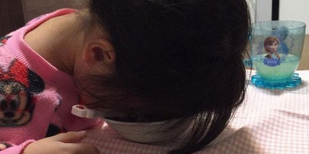 This toddler was far too tired to finish her meal. Or find a better place to rest her head. Photo / Twitter