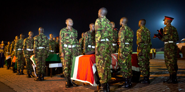Military pallbearers stand to attention next to coffins of Kenyan soldiers who were killed in Somalia. Photo / AP