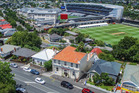 An elevated view of the orange-roofed former Kingsland fire station showing its closeness to Eden Park.