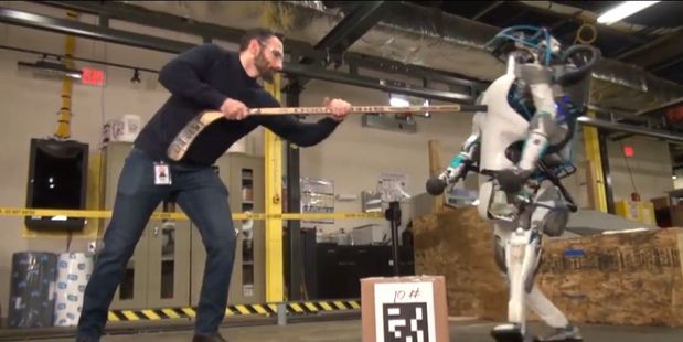 Loading Video footage of an engineer torturing a 5'9 robot has sparked debate on whether this is the start of a robot uprising.