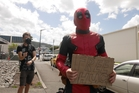 Thomas Hayman, aka Deadpool, is giving out free hugs to young and old. Photo / Alexandra Newlove