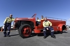 Tauranga volunteer firefighters with a 1950 Ford firetruck. Photo/George Novak