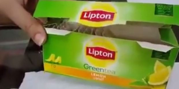 Tiny yellow strips in Lipton tea bags were thought to be worms. Photo / YouTube