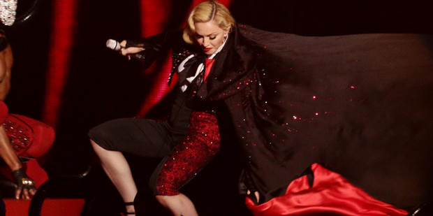 Madonna takes a stumble down stairs whilst performing on stage, during the 2015 Brit Awards at the O2 Arena, London.
