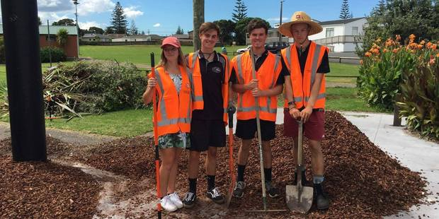 Casey McAnnelly, Harry Cooper, Tyler Broughton, Ryan Earwaker working for Mr Broughton's landscaping business. Photo / Supplied