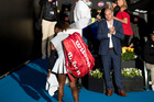 Serena Williams walks past tournament director Karl Budge after her shock loss against Madison Brengle. Photo / Dean Purcell