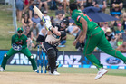 Black Caps player Colin Munro gets stuck into one during action in the T20 Cricket International played between the New Zealand Black Caps and Bangladesh. Photo / Alan Gibson