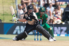 Black Caps player Colin Munro gets stuck into one. Photo / Alan Gibson