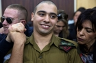 Elor Azaria was supported by friends and family as he waited for the verdict to be read out. Picture / AP