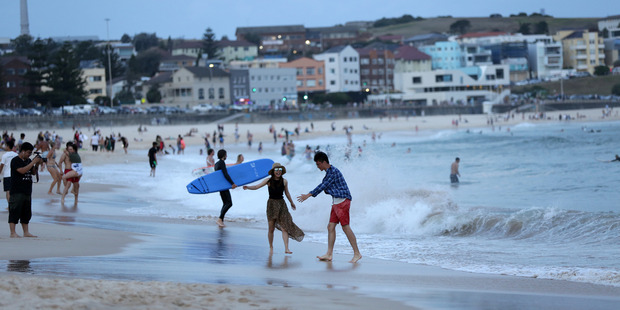 People trying to cool down in Sydney in December. Photo / News Ltd