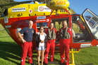 Leanne Turner with the Auckland Rescue Helicopter Trust crew after they arrived on Urupukapuka Island. PHOTO/supplied