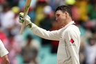 Peter Handscomb salutes the dressing-room and fans after making a century. Photo / AP