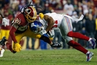 Will crunching hits like this inflicted by Washington Redskins back Greg Toler on New York Giant Sterling Shepard become a distant memory? Photo / AP