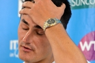 A dejected Bernard Tomic after his early exit. Photo / Getty Images
