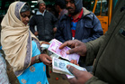 India yanked most of its currency bills from circulation without warning, delivering a jolt to the country. Photo/AP