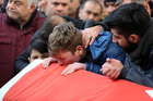 Family members and friends mourn as they attend funeral prayers for Ayhan Akin, one of the nightclub victims, in Istanbul. Photo / AP