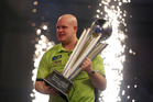 Michael van Gerwen of the Netherlands celebrates winning with the Sid Waddell trophy on the last day of the World Darts Championship. Photo / AP