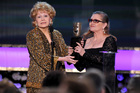 Carrie Fisher presents her mother Debbie Reynolds with the Screen Actors Guild life achievement award in 2015. The pair will likely be honoured by the Golden Globes next week. Photo/AP