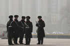 Chinese paramilitary policemen prepare to change their shifts on Tiananmen Square in Beijing. Photo / AP