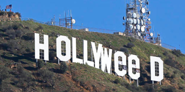 Los Angeles residents awoke New Year's Day to find a prankster had altered the famed Hollywood sign. Photo / AP