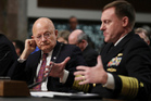 Director of National Intelligence James Clapper (left) listens as National Security Agency and Cyber Command Chief Adm, Michael Rogers testifies on Capitol Hill in Washington. Photo / AP