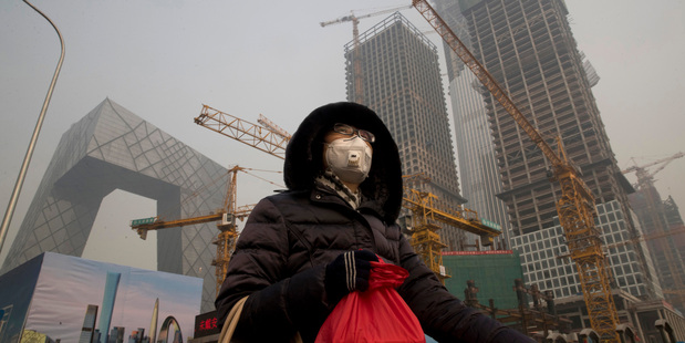 Face masks have become a common sight around Beijing where residents are concerned about the long-term effects of pollution on health. Photo / AP