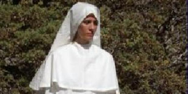 "Afton Burton aka ""Star"" in white robes. Photo / Supplied"