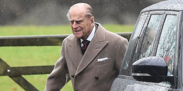 Prince Philip, 95, seemed in good spirits despite the inclement weather. Photo / AP