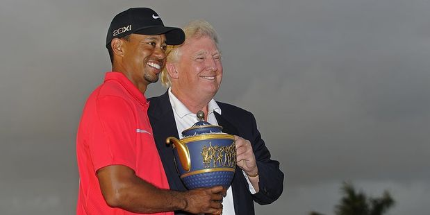 Tiger Woods poses with the Gene Sarazen Cup after winning the World Golf Championships Cadillac Championship in 2013. Photo / Getty Images
