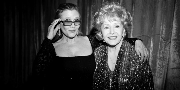Carrie Fisher and Debbie Reynolds' friends, family and fellow celebs gathered for their funeral today. Photo / Getty Images