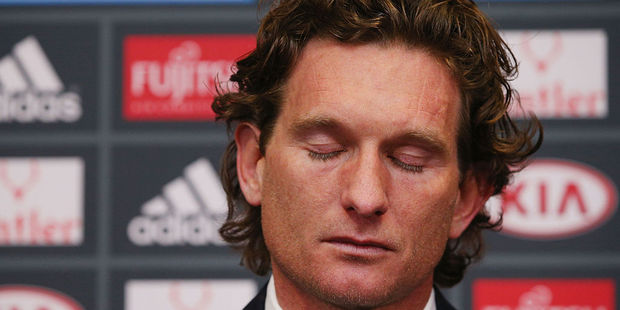 Former Essendon Bombers head coach James Hird cries as he talks to the media following the announcement of his resignation. Photo / Getty Images