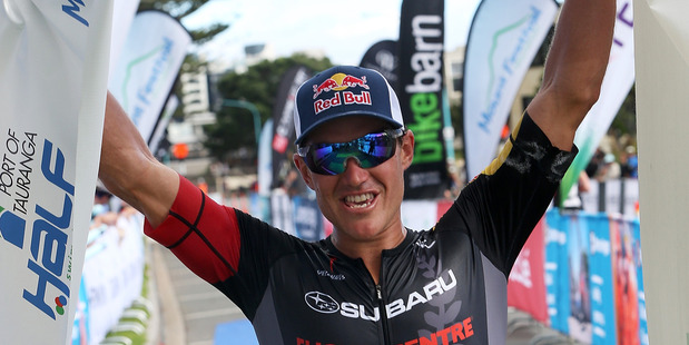 Braden Currie enjoying the victory at the Port Tauranga 1/2 Ironman Triathlon. Photo / Getty Images