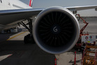 A Rolls Royce jet engine on an Emirates Airlines Boeing 777 passenger plane. Photo / Getty Images