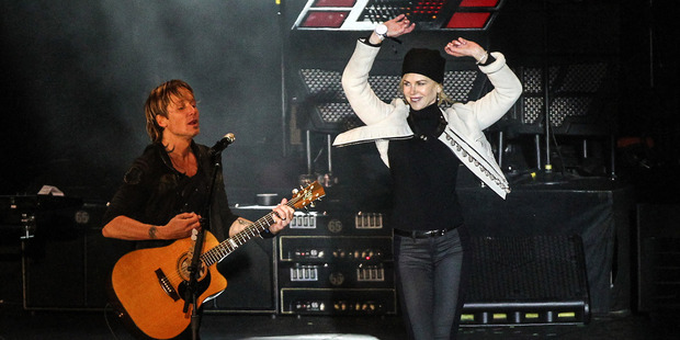 Loading Nicole Kidman waves her arms as husband Keith Urban performs in Nashville, Tennessee. Photo / Getty Images