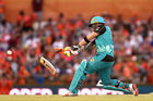 Brendon McCullum breaks his bat as he plays a shot during the Big Bash League match between the Perth Scorchers and the Brisbane Heat. Photo / Getty Images