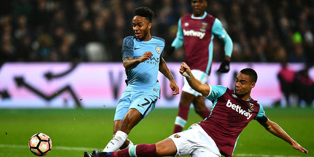 Raheem Sterling has his shot blocked by Winston Reid. Photo / Getty Images