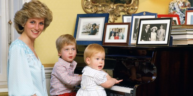 Diana with her sons, Prince William and Prince Harry, at the piano in Kensington Palace. Photo / Getty Images
