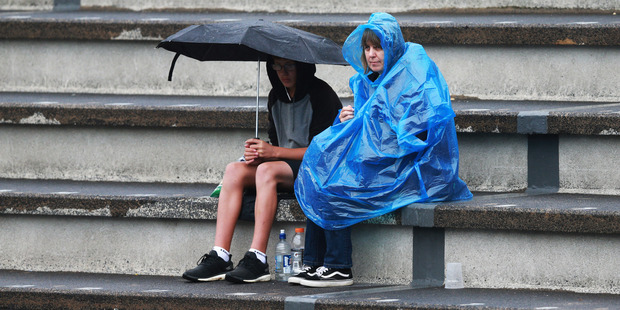 Loading Rain stops play at the ASB Classic tennis, where fans are waiting for the first appearance of Serena Williams. Photo / Doug Sherring