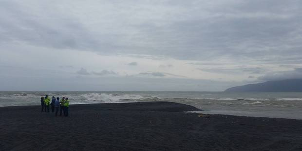 A search and rescue operation is underway for a man who has been washed out to sea at Lake Ferry. Photo / Wairarapa Times Age