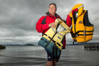 BE SAFE: President of Coastguard Rotorua Barry Grouby urges people to wear lifejackets when out on the water. PHOTO/BEN FRASER