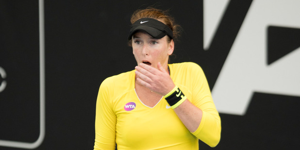 Madison Brengle reacts after beating Serena Williams. Photo / Dean Purcell