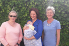 Whanganui Space team support person Lee Cameron-May, facilitator Raewyn Hiroti and her grandson William with facilitator Anna Savage.