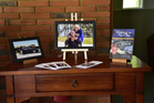 The funeral service tribute table to Ken Hogg featuring a photo of Mr Hogg and wife Barbara, his book and a photo of his last Jaguar.  Photo/supplied