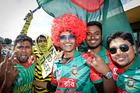 HIGH SPIRITS: Mehedi Hassan, centre, is having a great day with his Bangladeshi mates. Photo / Andrew Warner