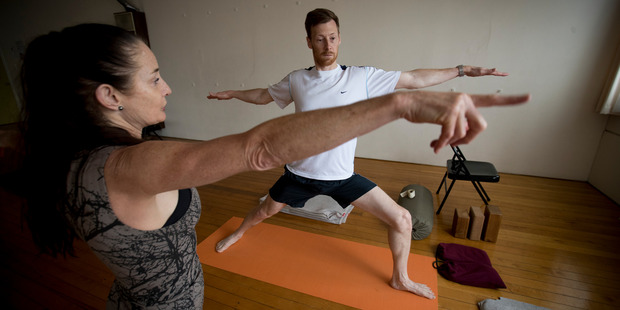 Canvas reporter Greg Bruce gets instruction from yoga teacher Jude Hynes. Photo / Dean Purcell