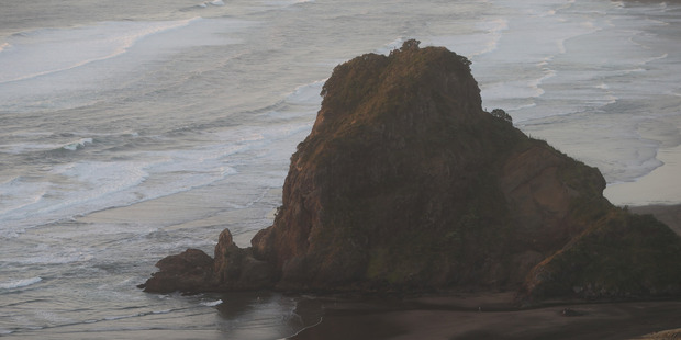 Two people had to be rescued after getting into trouble late at night at Piha. Photo / File