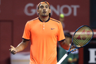 Australia's Nick Kyrgios reacts after getting a point against Gael Monfils. Photo / AP