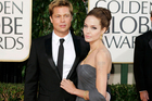 Angelina Jolie is giving Brad Pitt what he wants, but not without one last swipe. Photo / AP