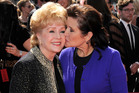 Carrie Fisher kisses her mother, Debbie Reynolds. Photo / AP