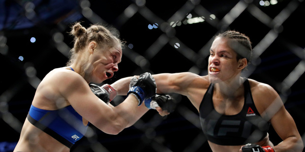 Amanda Nunes landed the blows but Ronda Rousey got almost all of the money. Photo / AP
